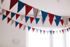 Fabric flags in white room Royalty Free Stock Image