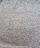 Fabric fleece, Color grey melange. Beautiful textile backdrop. Close-up. Top view Stock Photography