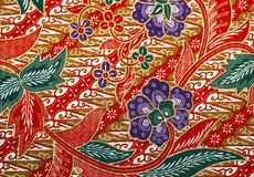 Fabric with floral batik pattern Stock Photos