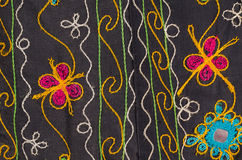 Fabric with floral motives texture. Full frame take of handmade fabric with floral motives Stock Photography
