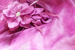 Fabric flower and beads on pink background Royalty Free Stock Image