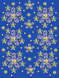 Fabric Flowers on Blue Specks. Blue speckled background is covered in clusters of large and small, plaid fabric, flowers.  Purple encircled yellow polka dots Royalty Free Stock Photo
