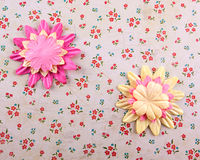 Fabric flowers. A  close up of  a fabric flowers on a flowery background Royalty Free Stock Images