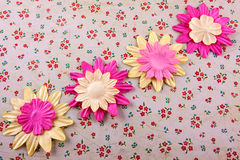 Fabric flowers. A  close up of  a fabric flowers on a flowery background Stock Photos