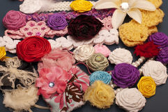 Fabric flowers. Colorful fabric flowers and headbands Stock Photos