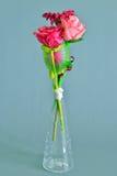 Fabric flowers in tubular transparent glass vase Stock Photo