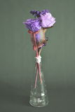Fabric flowers in tubular transparent glass vase Royalty Free Stock Photo