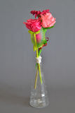 Fabric flowers in tubular transparent glass vase Stock Photography