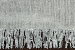 Fabric with fringe. A fragment of fabric with fringe stock photography
