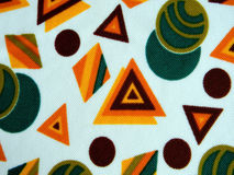 Fabric from a grandmother's chest. Fabric from geomentricheskiya color drawing on a white background. Colors: brown, green, olive, orange, yellow Royalty Free Stock Photography