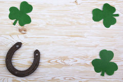 Fabric green clover leaves with horseshoe on wooden background. Royalty Free Stock Photo