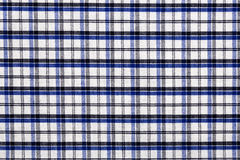 Fabric into grid, a background or texture Royalty Free Stock Image