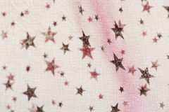 Fabric grunge christmas background with stars pattern Stock Images
