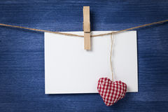 Fabric heart and empty card on wooden background Royalty Free Stock Photo