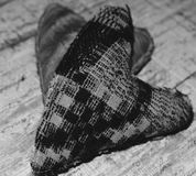 Fabric hearts. Black and white still photo with blur background Stock Images
