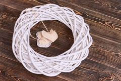 Fabric hearts on brown wood. White willow wreath. Nest of love stock image