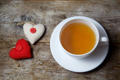 Fabric hearts and cup of tea royalty free stock photo