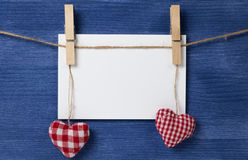 Fabric hearts and empty card on wooden background Royalty Free Stock Image