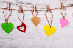 Fabric hearts pinned to rope. Royalty Free Stock Photos