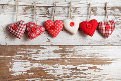 Fabric hearts. On a wooden background Royalty Free Stock Images