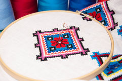 The fabric in the hoop with embroidery Stock Image
