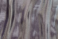 Fabric with iridescent stains of motley color Stock Images