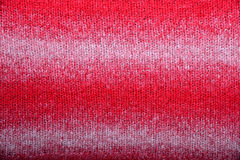 Fabric knitted red wool background Royalty Free Stock Photos