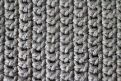 Fabric, knitted from yarn, close-up. The background Stock Photos