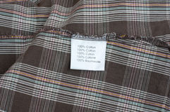 Fabric label. Written in five languages Stock Photos