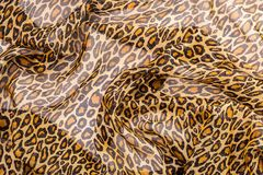Fabric with leopard print. For clothes ,ginger stock photo