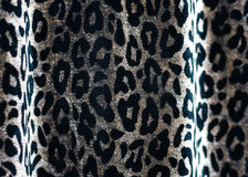 Fabric with leopard skin pattern Royalty Free Stock Images