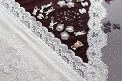 Fabric, lingerie tull and different sewing supplies Royalty Free Stock Photography