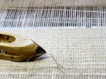 Fabric on the loom Stock Photo
