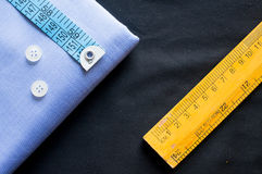 Fabric with measuring tape, buttons and wooden scale Stock Image