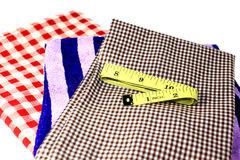 Fabric and Measuring Tape on white background Royalty Free Stock Photos