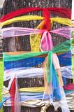 Fabric in multicolor on tree Royalty Free Stock Image