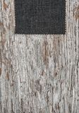 Fabric on old weathered wood background. Fabric on the old weathered wood background stock photos
