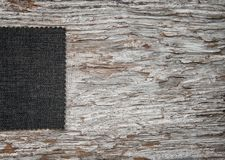 Fabric on old weathered wood background. Fabric on the old weathered wood background royalty free stock photography