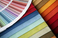 Fabric and opened color card. Samples of a fabric and opened color card with various colors Royalty Free Stock Photography