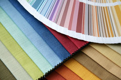Fabric and opened color card Royalty Free Stock Photos