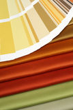 Fabric and opened color card Stock Photos