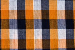 Fabric into orange grid, a background Royalty Free Stock Image