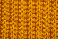 Fabric orange knitted texture background with scarf clothing Royalty Free Stock Images