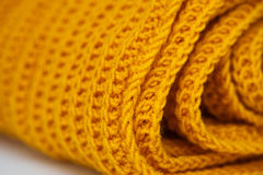 Fabric orange knitted texture background with scarf clothing Stock Photo