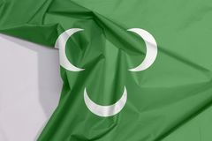 Fabric Ottoman Tripolitania 18th century flag crepe and crease with white space. Three white crescent on green royalty free stock image