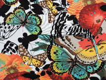 Fabric with painted butterflies Stock Photography