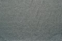 Fabric of pale gray green with rhombuses Stock Photos
