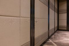 Fabric panels door covered acoustic board pattern surface texture in hotel. Interior material for design decoration background.  stock photography