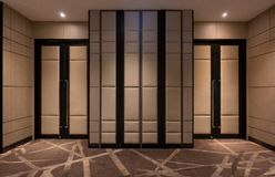Fabric panels door covered acoustic board pattern surface texture in hotel. Interior material for design decoration background.  stock images