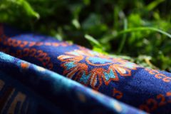 Fabric with a pattern on the grass royalty free stock photo
